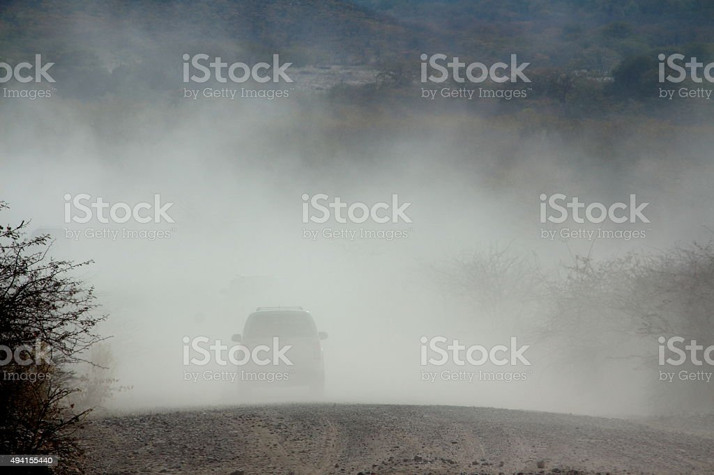 Vehicles in the dust stock photo