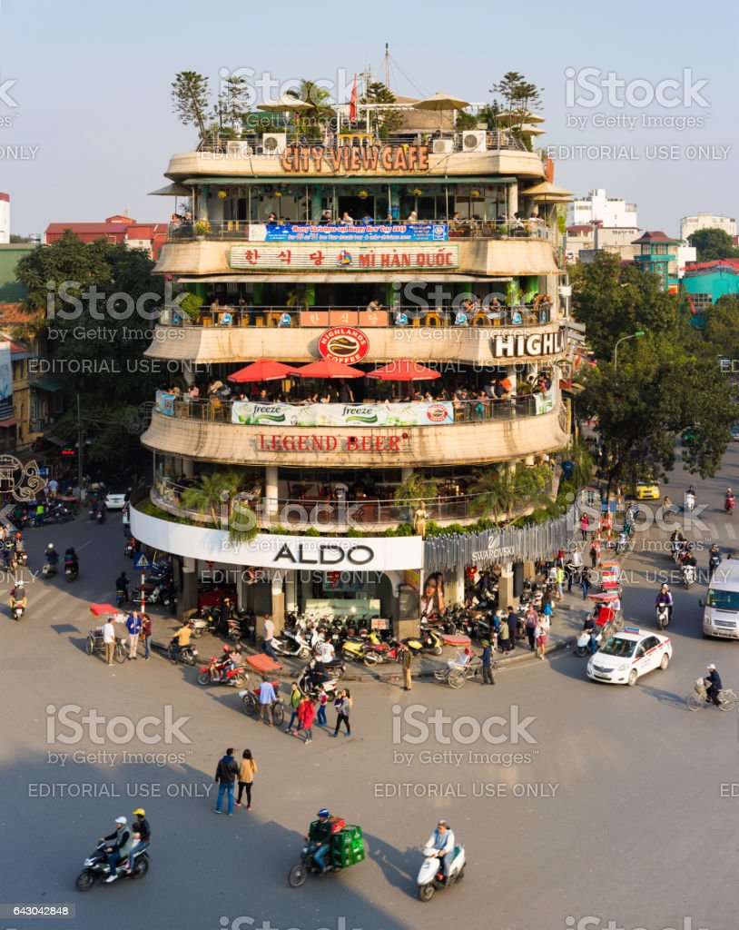 Hanoi, Vietnam - Jan 1, 2015: Vehicles running on a busy street near Hoan Kiem lake (Sword lake) in Hanoi capital, Vietnam. This area is the center of Hanoi stock photo