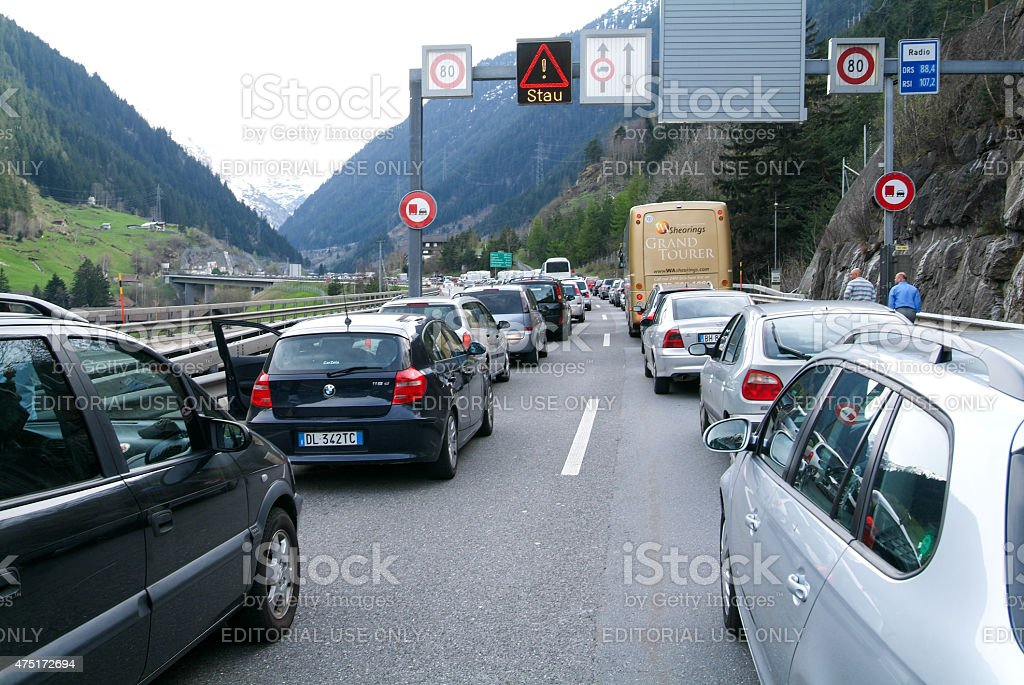 vehicles waiting in line for entering Gotthard tunnel stock photo