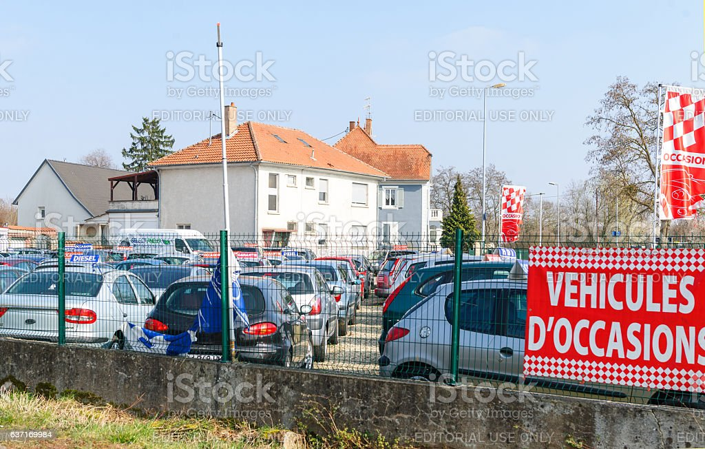 Vehicules d'Occasion translating as Used Cars garage stock photo
