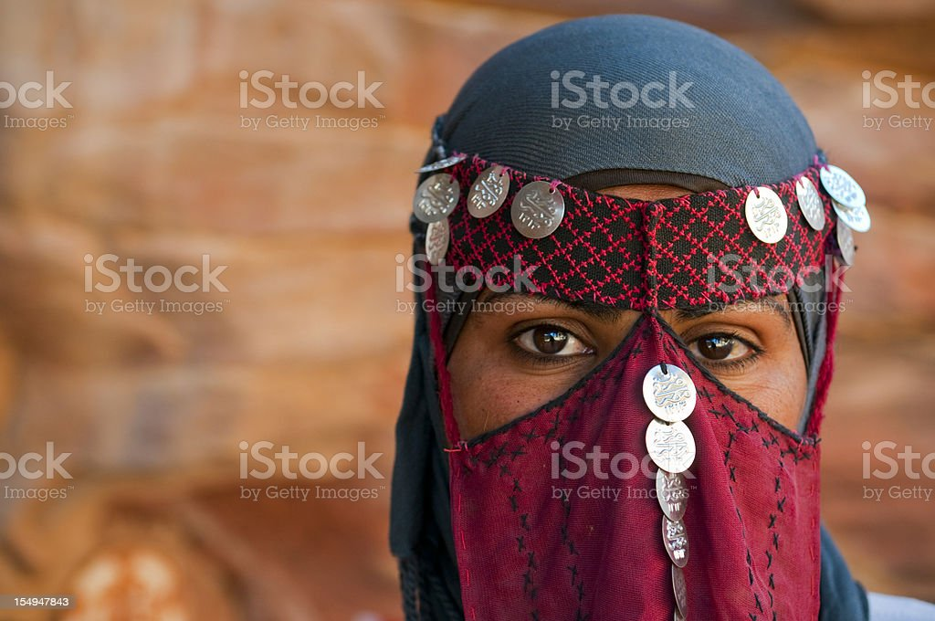 Veiled Bedouin woman in Jordan stock photo