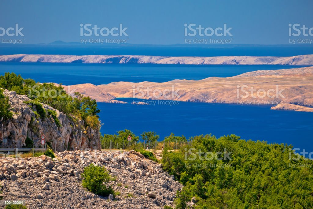 Velebit channel seaside road and desert islands of Pag and Rab view, scenic route in Croatia stock photo
