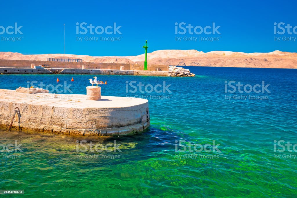 Velebit channel turquoise waterfront in Karlobag and desert island of Pag view, Croatia stock photo