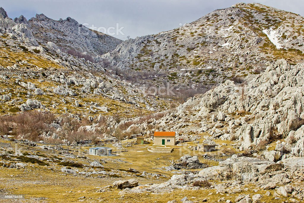 Velebit stone desert and mountain shelter view stock photo