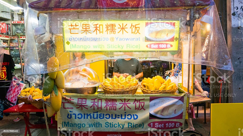 Vender selling  mango on chinatown (Yaowarat) Road. stock photo