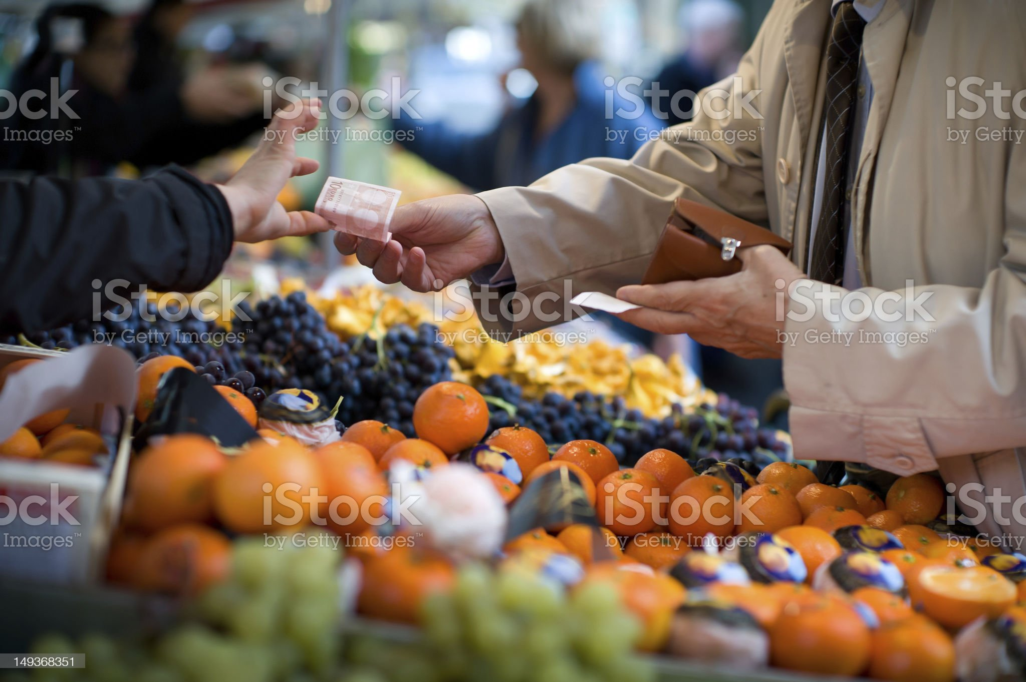 Vendor accepts payment at a street market royalty-free stock photo