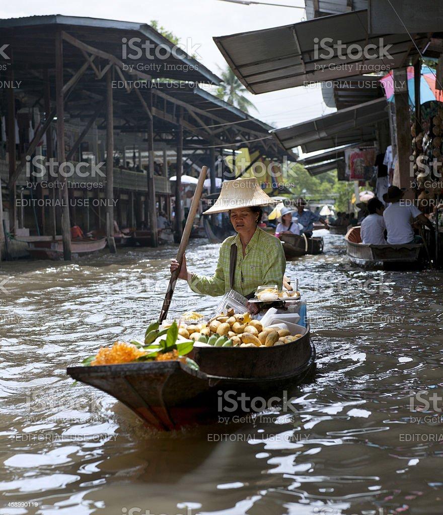 vendor at Damnoen Saduak floating market, Thailand royalty-free stock photo
