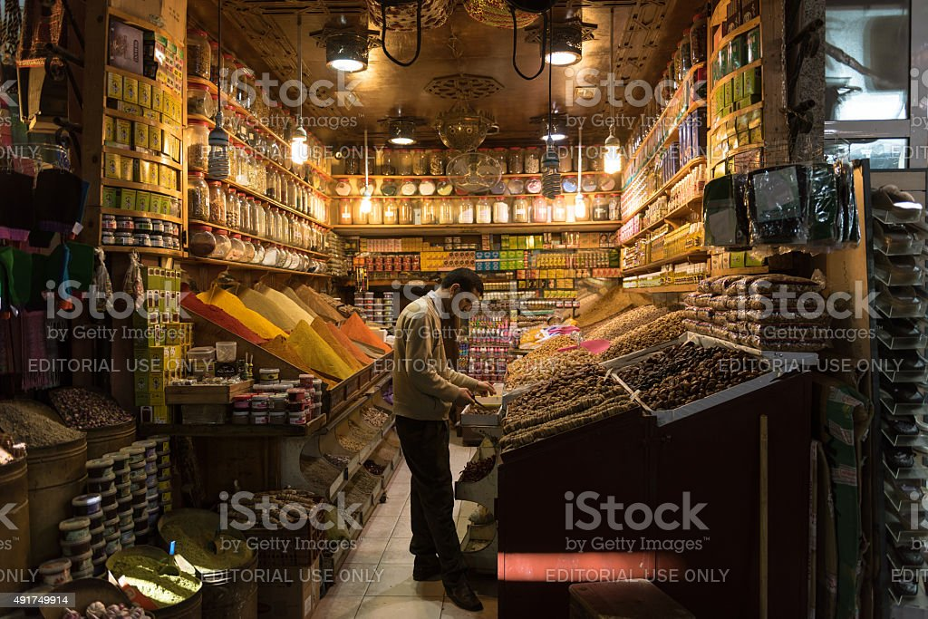 Vendor of dried fruits and spices in Marrakech stock photo