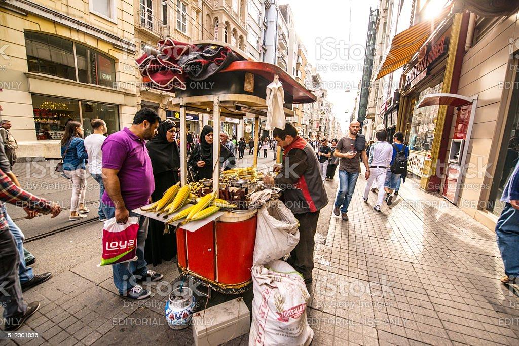 Vendor selling corn on Istiklal Avenue, Istanbul stock photo