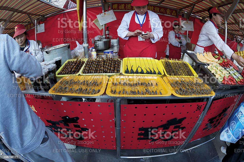 Vendor selling scorpions and silk worms at Beijing snack market royalty-free stock photo