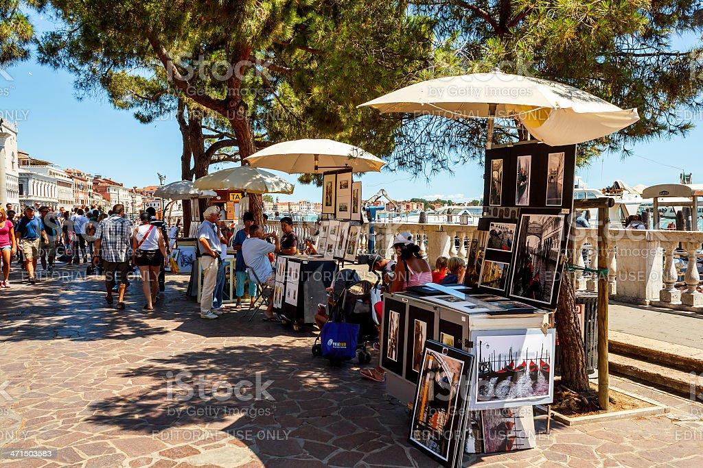 Vendor selling tourist souvenirs in Venice. stock photo