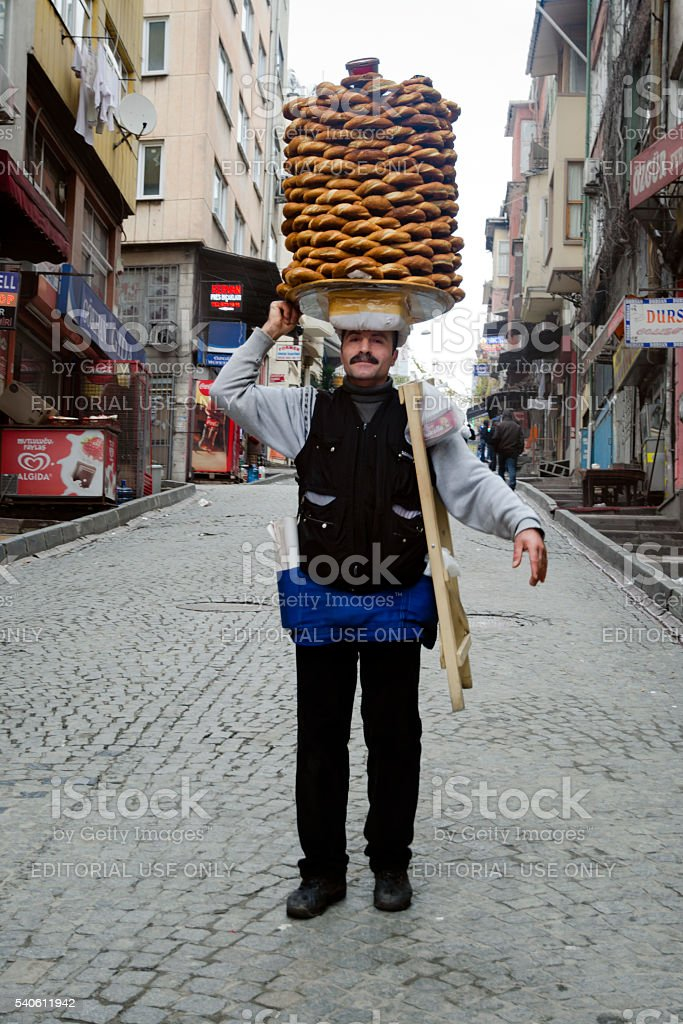 Vendor sells simit, Turkish bread in the streets stock photo