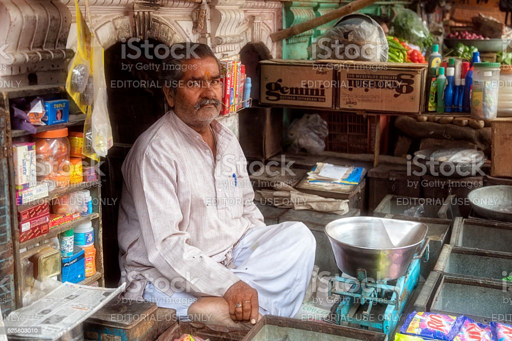 Vendor sitting at his street stall Bikaner, Rajasthan, India stock photo