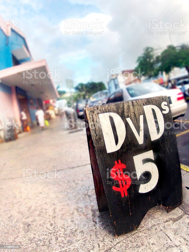 vendor street sign with dvd's on sale stock photo