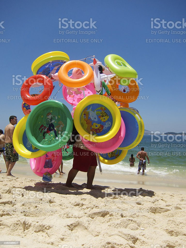 Vendor Walks with Colorful Beach Toys Rio de Janeiro stock photo