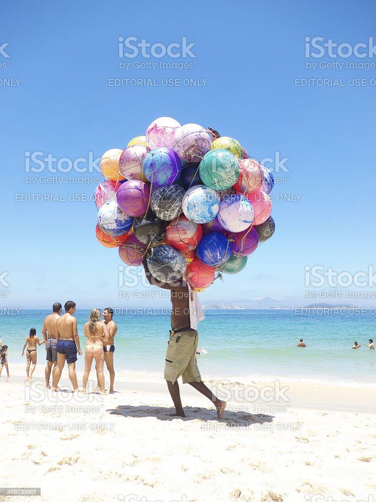 Vendor with Colorful Beach Balls Ipanema Rio de Janeiro Brazil stock photo