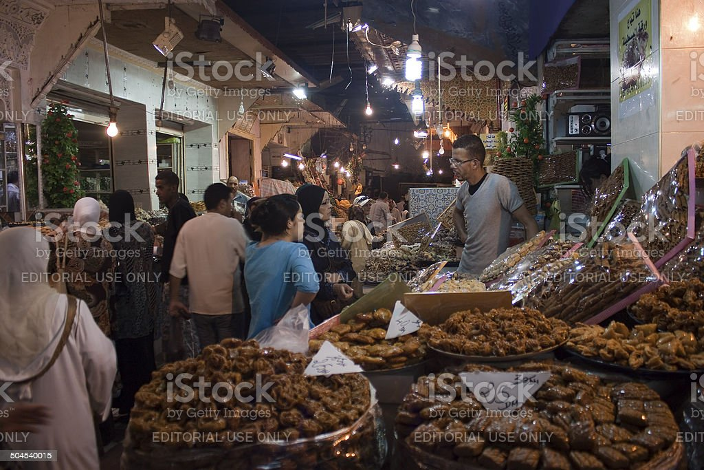 Vendors and customers stand by sweets stall royalty-free stock photo