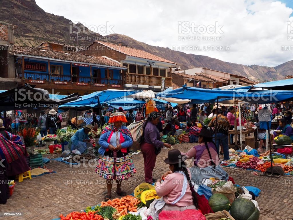 Vendors selling vegetables at a market in Pisac stock photo