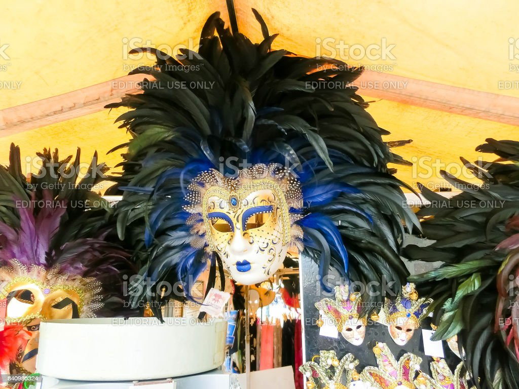 Vendors stands - profitable and popular form of sales traditional souvenirs and gifts like masks, magnets, clothes and travel guides to tourists visiting Venice. stock photo