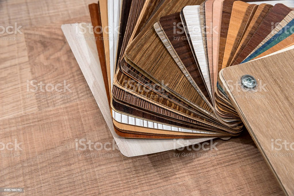 Veneer packs contain samples of blackwood on desk stock photo