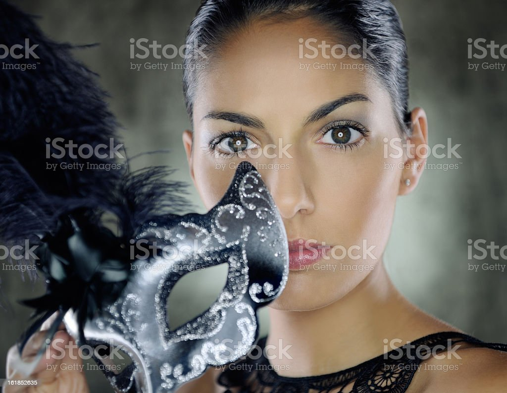 Venetian Beauty lifting her Disguise royalty-free stock photo