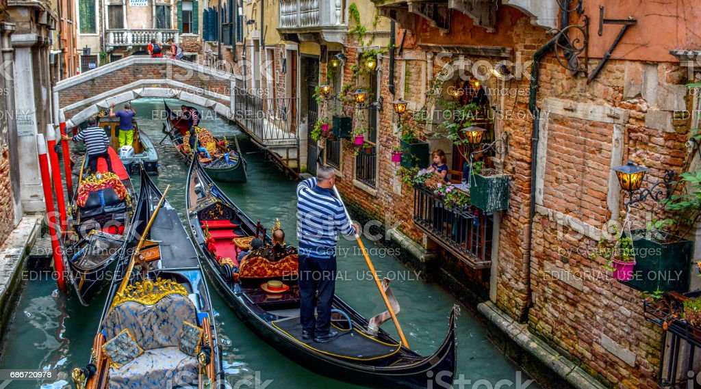 A Venetian Canal by the Trattoria Sempione, Venice Italy stock photo