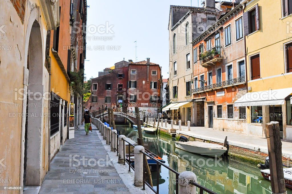 Venetian canal during the midday in Venice, Italy. stock photo