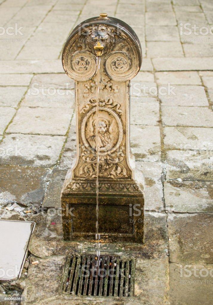 Venetian column with drinking water stock photo