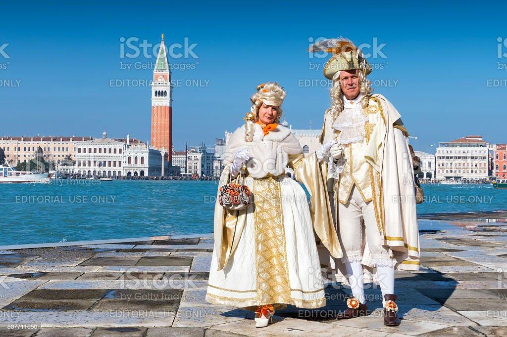 Venetian Couple in front of Saint Mark's Campanile stock photo
