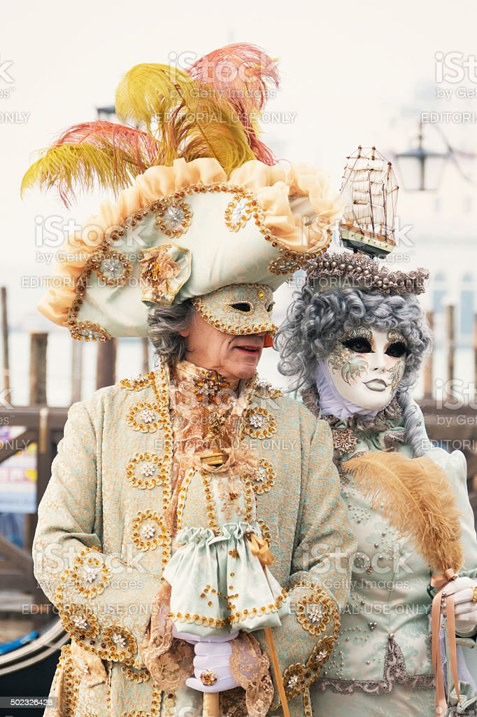 Venetian Couple in Gold and Silver stock photo
