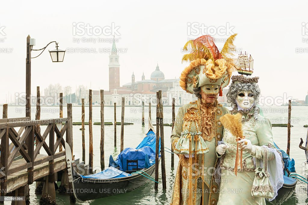 Venetian Couple on gondola's pier stock photo