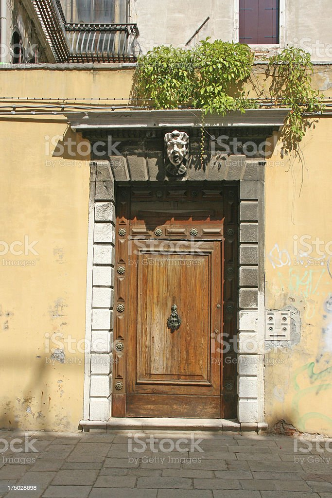 Venetian door, venice, italy. royalty-free stock photo