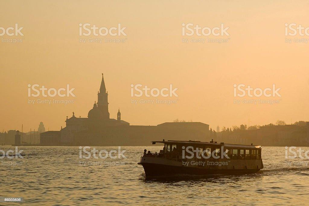 Venetian Ferry at Sunrise stock photo