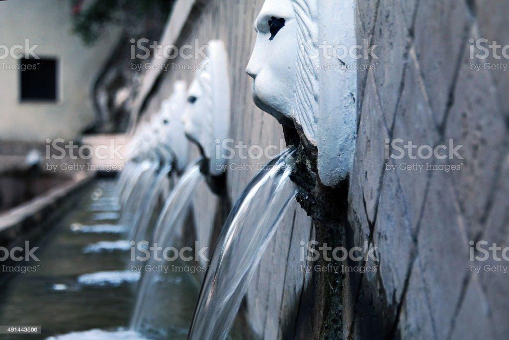 Venetian fountain in Spili stock photo