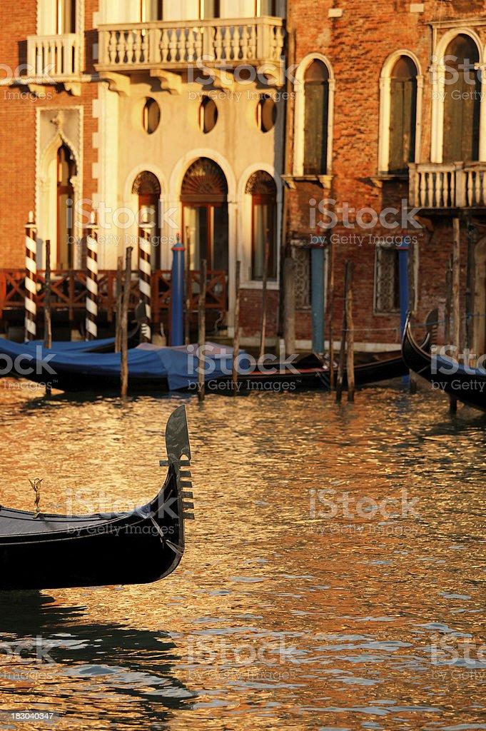 Venetian gondola in the warm morning lights royalty-free stock photo