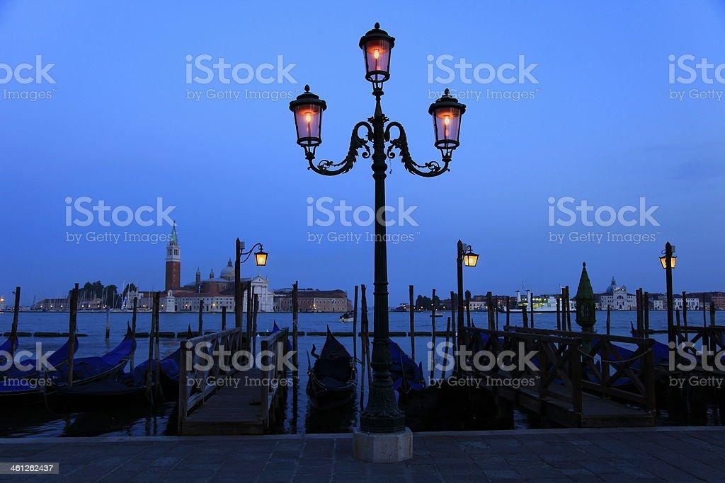 Venetian Gondolas at night - Lamps in Venice pier, Italy royalty-free stock photo