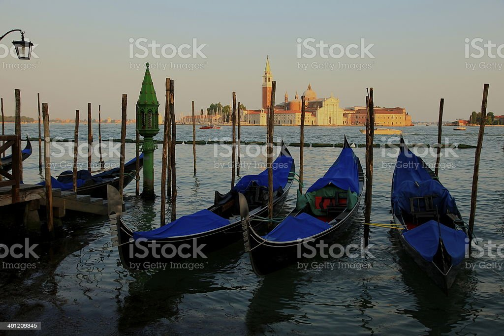 Venetian Gondolas at sunset - Pier in Venice, Italy royalty-free stock photo