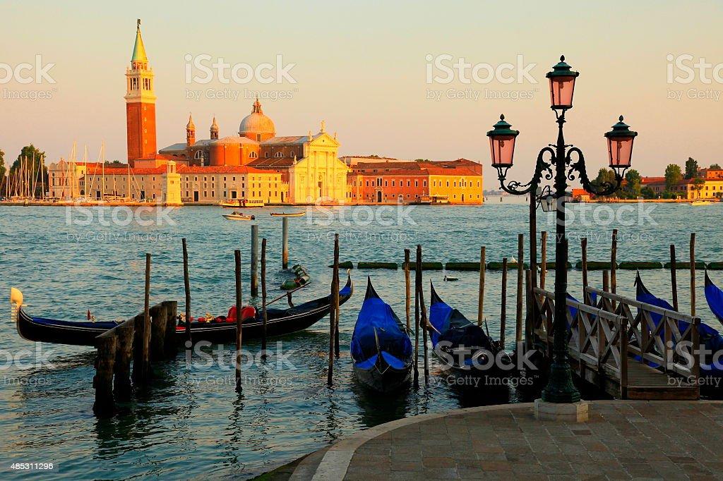 Venetian gondolas, San Marco and San Giorgio Maggiore at sunset, Venice stock photo