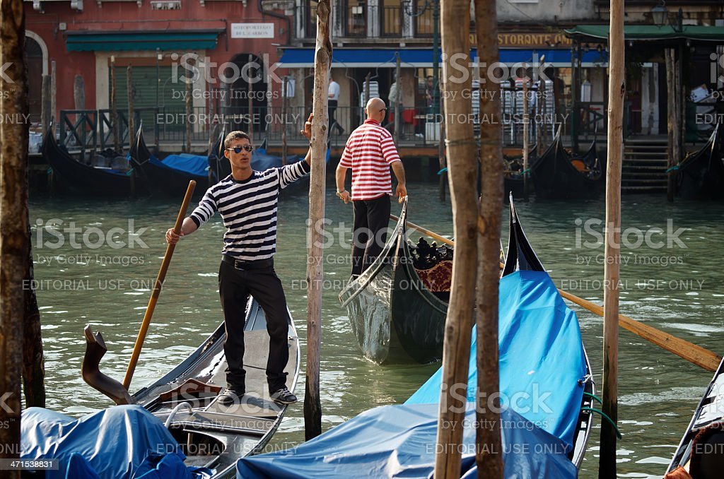 Venetian Gondoliers Work on Gondolas Grand Canal Venice Italy royalty-free stock photo
