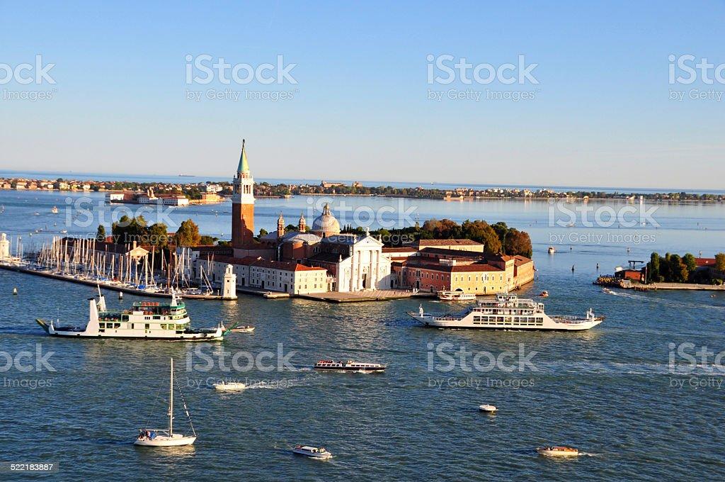 Venetian lagoon with ships and San Giorgio Maggiore aerial view stock photo