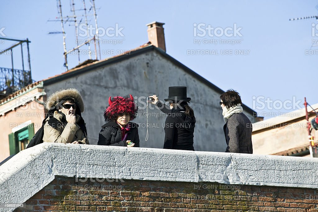 Venetian mask among the people royalty-free stock photo