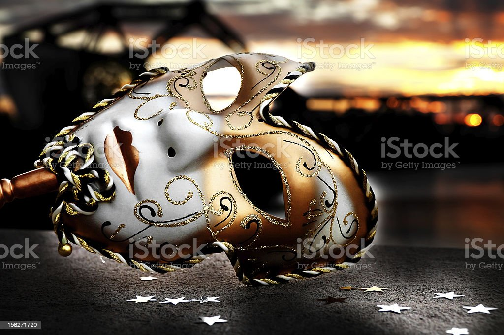 Venetian Mask by the River Bridge with Sunset stock photo