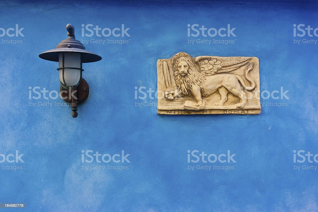 Venetian plate on blue royalty-free stock photo