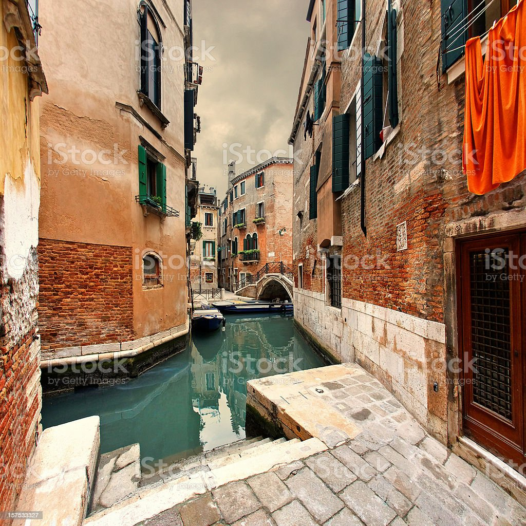 Venetian street and canal on a gloomy day royalty-free stock photo