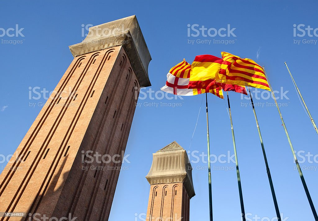 Venetian towers with flags in Pla?a d'Espanya, Barcelona. royalty-free stock photo