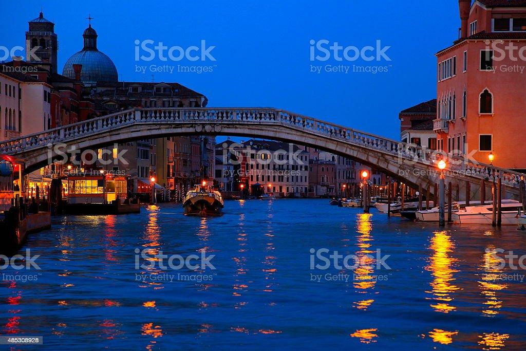Venetian vaporetto, Grand Canal, bridge and architecture at evening, Venice stock photo