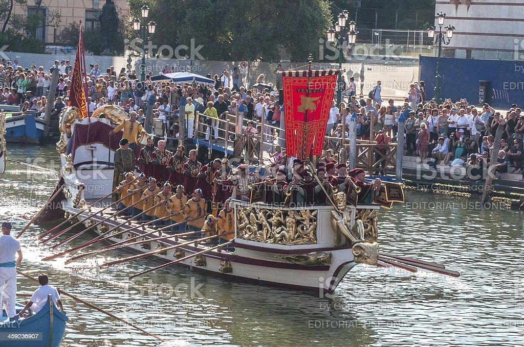 Venetians and world travelers celebrate Venice's historic gondolas royalty-free stock photo