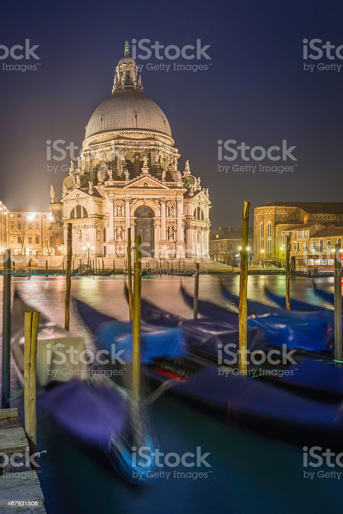 Venice at night Salute Basilica gondolas Grand Canal illuminated Italy stock photo