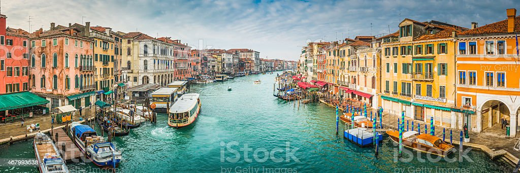 Venice boats on busy Grand Canal waterway between palazzo Italy stock photo