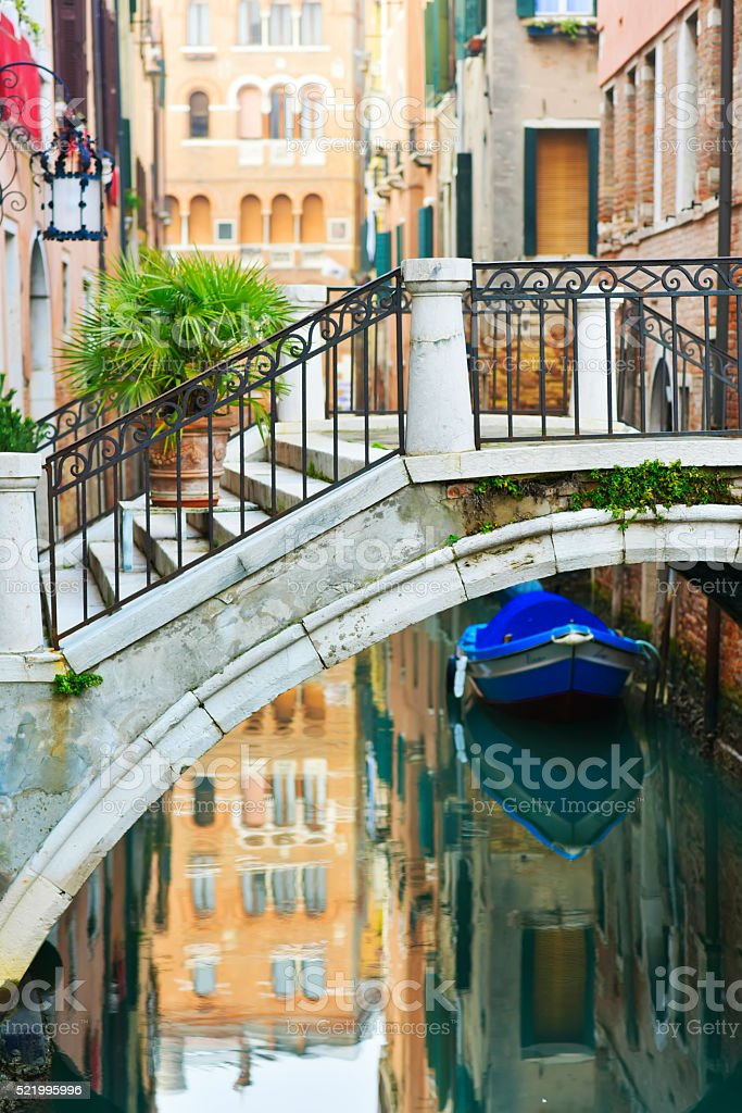 Venice Bridge and boat, Italy stock photo